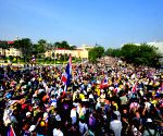 Anti-government protesters march during a rally outside Government House in Bangkok