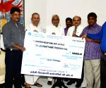 Barauni refinery workers presents a cheque for the Relief fund