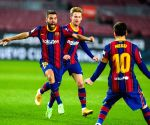 Barcelona keep title hopes alive with 2-0 win over Sevilla
