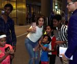 Sara Ali Khan is all smiles as she poses with kids at airport!