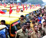 Auto-rickshaw drivers during a programme