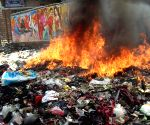 Garbage being disposed by burning at a garbage dump