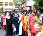 Bengaluru : Garment workers standing in a queue for vaccination at Industrial estate Rajajinagar, in Bengaluru.