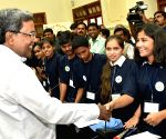 Siddaramaiah interacting with children
