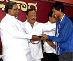 Karnataka CM felicitates students of Kannada language
