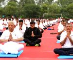 Karnataka Governor joins thousands at Yoga Day event