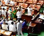 Opposition party MLAs protesting during a budget session at Vidhana Soudha, in Bengaluru on Thursday 4th March 2021