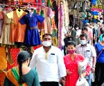 Bengaluru : People shopping at Malleshwaram commercial area after certain restrictions of COVID - induced lockdown were eased, in Bengaluru.