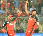 RCB maul listless KKR by eight wickets, go atop
