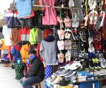 Bengaluru : Shops owners waiting for the customers at Majestic amid ongoing Coronavirus lockdown, in Bengaluru.