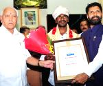 Karnataka honours Kambala jockey Gowda with Rs 3 lakh