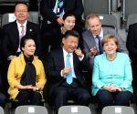 GERMANY CHINA XI JINPING MERKEL YOUTH FOOTBALL MATCH