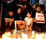 Palestinians light candles