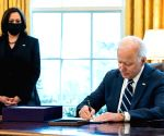 Biden signs executive order revoking measures issued by Trump
