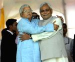 Nitish-Lalu hug each other during the swearing-in ceremony of the new JD-U-RJD-Congress coalition government