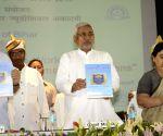 """Nitish Kumar releasing a book """"Bihar Police Eeek"""""""