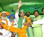 Tej Pratap Yadav participates in a chariot procession