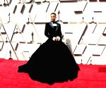 Billy Porter breaks sartorial barrier at Oscars 2019