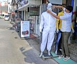 With mannequins in PPE kits, Birbhum shopkeepers spread awareness