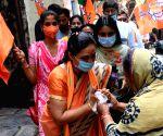 Kolkata :BJP candidate Jorashanko Mina Devi Purohit at a election campaign during State Assembly election in Kolkata.