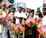 Rahul Sinha distribute kites ahead of Biswakarma Puja