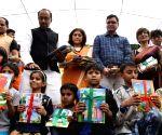 Vijay Goel, Roopa Ganguly distribute books to children
