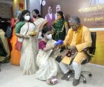 BJP Mahila Morcha activists tie rakhis to Dilip Ghosh during Raksha Bandhan celebrations