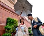 Parliament -Hema Malini shares umbrella with Farooq Abdullah