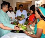 R.K. Sinha distributes material for Chhath Puja