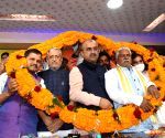 BJP MP Sushil Kumar Modi being garlanded by party leaders during the birth anniversary celebration of Guru Ravidas