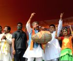 BJP National General Secretary, Kailash Vijayvargiya playing Dhol on the occasion of All India Kirtan and Baul Singer Association program at Sahid Minar Ground on Tuesday 02nd March 2021
