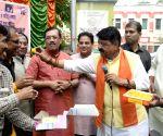 BJP's Kailash Vijayvargiya celebrates after Parliament passes CAB