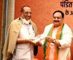 Free photo: BJP President JP Nadda greets party veteran Vijay Kumar Malhotra during a program on the occasion of Bharatiya Jansangh leader Deendaya Upadhyaya birth anniversary at BJP head office in New Delhi.