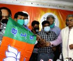 BJP State President Dilip Ghosh handed over party flag to newly joining from CPI(M) party