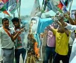 BJP workers burn effigies Rahul Gandhi