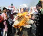 BJP workers burns an effigy of political leaders