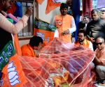 BJP distributes mosquito nets at city hospital