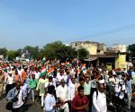 BJP leaders take out march demanding legislation on curbing population