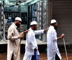 Blind people offer Eid namaz