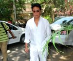 Bollywood actor Danny Denzongpa outside filmmaker Prakash Mehra's residence. Mehra passed away Sunday morning.