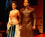 Bollywood actors Genelia D'Souza and Tusshar Kapoor at the ramp for Designer Manish Malhotra at the Lakme Fashion week 2009.
