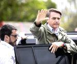Bolsonaro defends move to open businesses