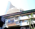 Sensex falls 300 points on weak global cues