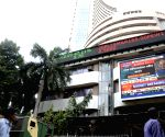 Sensex trims losses as rupee gains over 50 paise