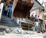 BBMP demolishes illegal structures on footpaths