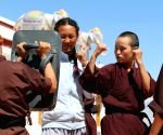 Free Photo: Buddhist Kung Fu nuns kicking hard at centuries-old taboos