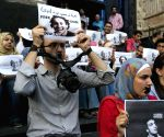 Egyptian photojournalists hold a silent protest calling for the release of fellow journalist Abou Zeid in Cairo