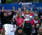 Egyptians shout slogans during a campaign rally
