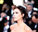 Victoria Beckham pokes fun at her Burberry bandana of 2000
