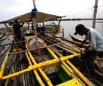 Cavite Province: Fishermen secure their boat in Cavite Province, the Philippines